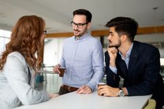Business people chatting and drinking coffee at a conference i. N the office stock image