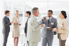 Business people chatting and drinking coffee at a conference Stock Photos