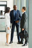 Business people chatting. Group of business people chatting after the meeting royalty free stock photo