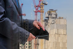 Business people check black wallet on building background,business concept. Double exposure Stock Images