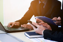 Business people check the finance graph in office. Stock Photos