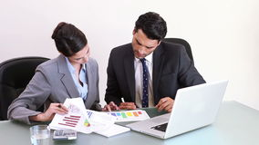 Business people checking charts Stock Photo