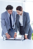 Business people checking file Stock Images
