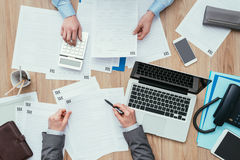 Business people checking tax forms Royalty Free Stock Photo