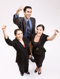 Business people cheering. At the camera Royalty Free Stock Photo