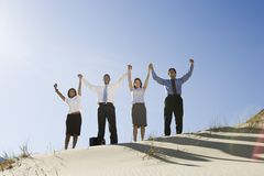 Business People Cheering In The Desert Stock Photography