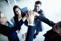 Business people cheering with hands together royalty free stock images