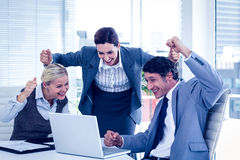 Business people cheering at laptop Royalty Free Stock Image