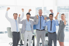 Business people cheering in office Royalty Free Stock Images