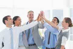 Business people cheering in office Royalty Free Stock Image