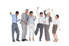 Business people cheering in office Royalty Free Stock Photos