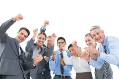 Business people cheering in office Royalty Free Stock Photo