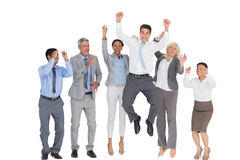 Business people cheering in office Stock Photos