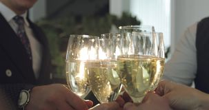 Business people cheers with a glass of champagne. A party in the office. Luxury celebration concept stock video footage