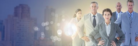 Business people and City buildings with flare light source. Digital composite of Business people and City buildings with flare light source Stock Photo