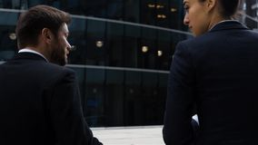 Business people in the city have conversation stock footage