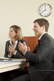 Business people clapping. In the office Stock Photography