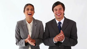 Business people clapping. Against a white background stock video footage