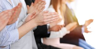 Business people clapping and applause at meeting or conference, close-up of hands. Group of unknown businessmen and royalty free stock photo