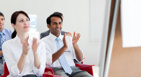 Business people clapping at a conference stock image