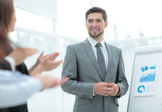 Business people clapping at conference. Business presentation. Successful business men in suit at the office leading a group Royalty Free Stock Image