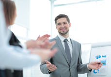 Business people clapping at conference. Business presentation. Successful business men in suit at the office leading a group Royalty Free Stock Photos