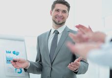 Business people clapping at conference. Business presentation. Successful business men in suit at the office leading a group Stock Image