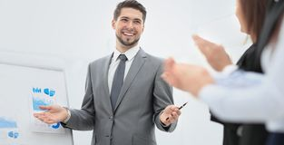 Successful business man at the office leading a group. Business people clapping at conference Stock Photos