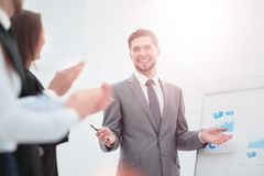 Successful business man at the office leading a group. Business people clapping at conference Royalty Free Stock Photos