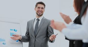 Successful business man at the office leading a group. Business people clapping at conference Stock Images