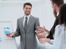 Business people clapping at conference. Successful business presentation of a men at the office Stock Photos
