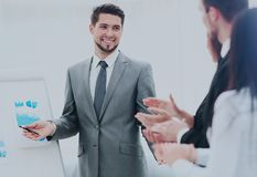 Business people clapping at conference. Successful business presentation of a men at the office Royalty Free Stock Images