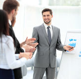 Business people clapping at conference. Successful  presentation of a men at the office Royalty Free Stock Photography