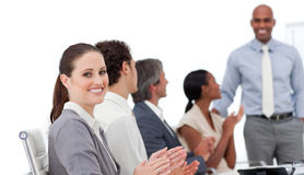 Business people clapping a good presentation. Positive business people clapping a good presentation in the office Royalty Free Stock Image