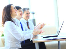 Business people clapping hands. Cropped image of business people clapping hands during meeting at office Royalty Free Stock Images