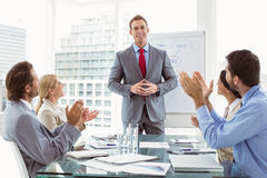 Business people clapping hands in board room meeting. Young business people clapping hands in board room meeting at office Royalty Free Stock Photo