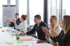 Business people clapping hands during the meeting Stock Images