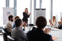 Business people clapping hands during the meeting Stock Image