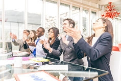 Business people clapping hands. Multiracial group of business people clapping hands to congratulate their boss - Business company team, standing ovation after a Royalty Free Stock Image