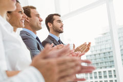 Business people clapping hands in office Stock Photo