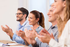 Business people clapping hands stock images