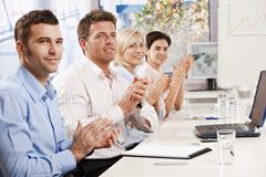 Business people clapping at meeting Royalty Free Stock Photography