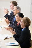 Business people clapping in meeting. Business people clapping in a meeting Royalty Free Stock Photography