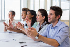 Business people clapping after presentation Royalty Free Stock Photo