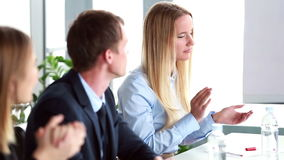 Business people clapping their colleague after presentation stock video