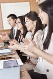 Business people clapping their hands Royalty Free Stock Images