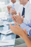 Business people clapping together Stock Photography