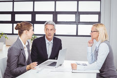 Business people with client in meeting room Royalty Free Stock Photography