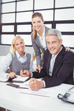 Business people with client in meeting room Stock Image