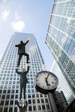 Business people climbing a building Royalty Free Stock Photos
